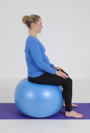 Pelvic tilt on a birthing ball